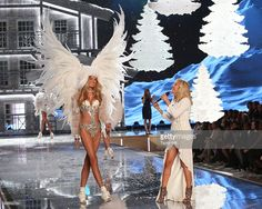 Musician Ellie Goulding performs as model Romee Strijd walks the runway during the 2015 Victoria's Secret Fashion Show at Lexington Avenue Armory on November 10, 2015 in New York City.