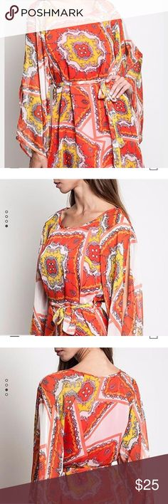 Boutique Umgee dress size Large Really pretty orange/yellow/pink/red Umgee brand dress. Size Large. NWT. Long bell sleeves with a slit at the shoulders. Dress falls mid thigh. Umgee Dresses Long Sleeve