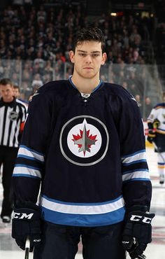 Oct.18 2015 - St.Louis 4 - Wpg. 2 - Adam Lowry #17 of the Winnipeg Jets stands on the ice during the singing of the national anthems prior to puck drop against the St. Louis Blues at the MTS Centre on October 18, 2015 in Winnipeg, Manitoba, Canada. (Photo by Jonathan Kozub/NHLI via Getty Images) Game and Event Photo Galleries