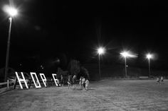 """Relay for life - """"The candlelit ceremony at dusk was the most memorable moment of the whole event. All teams followed the cancer survivors around the track for a silent walk. The silence of the field combined with the beautifully lit 'HOPE' sign was truly a moving experience to be part of."""""""