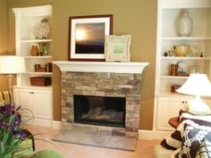 Love the stone fireplace!! Built in shelves on either side of the fireplace are a must.