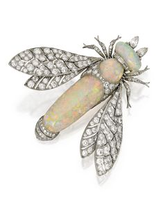 PLATINUM, OPAL AND DIAMOND BROOCH. Designed as an insect with the wings en tremblant, with two cabochon opals measuring approximately 38.0 by 11.1 mm and 13.3 by 6.2 mm, accented by baguette, old European, single-cut and pear-shaped diamonds weighing approximately 2.80 carats.  Edwardian or Edwardian style.