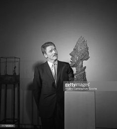 American actor Burt Lancaster, wearing a pinstriped suit and a tie, portrayed while standing next to Alberto Giacometti's sculpture 'La Grande Tete de Diego', at the Art Biennale, Venice, 1962. (Photo by Archivio Cameraphoto Epoche/Getty Images) Credit: Archivio Cameraphoto Epoche / contributor