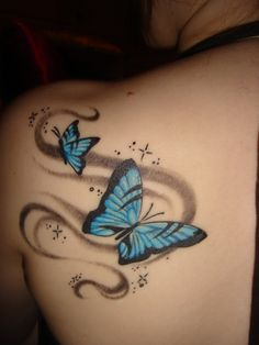"""Wanted to get something like this with the """"wisps"""" going up my spine to my butterfly and then adding a few small pink ones"""