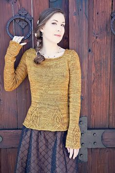 Rapunzel Sweater pattern by Anne Podlesak knit with our Sporty yarn. Shown here in the Midas Touch colorway.