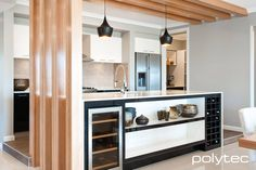 idea of wine rack in island.also black & white doors. Doors in CREATEC Black Wenge. Overhead cupboards in CREATEC Alabaster. New Kitchen, Kitchen Dining, Kitchen Decor, Kitchen Ideas, Kitchen Inspiration, Galley Kitchens, Home Kitchens, Kitchen Cabinetry, Cupboards