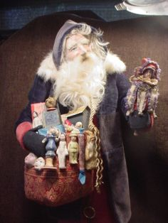 Santa with detailed miniature Marotte & toys by Norma DeCamp