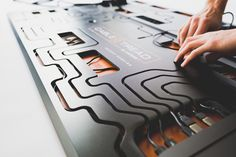This circuit board desk integrates a cabling solution to give you the ultimate wire-free desk setup! | Yanko Design Printed Circuit Board, Red Dot Design, Cable Organizer, Mac Mini, Yanko Design, Wifi Router, Desk Setup, Red Dots, Integrity