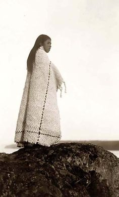 Here we present a stunning image of a Cowichan Girl. It was taken in 1913 by Edward S. Curtis.    The image shows Cowichan woman, full-length portrait, wearing blanket, standing on rock.    We have created this collection of images primarily to serve as an easy to access educational tool. Contact curator@old-picture.com.