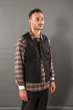 Connor in Freshwater Gilet, charcoal cotton wool nylon; Corp Shirt, grey clan check; Eaton Shirt, ecru jersey