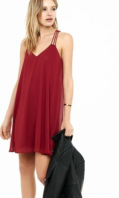 Turn your style up to Roman goddess with this extra-flowy, strappy trapeze dress. Semi-sheer chiffon layered over a silky lining gives you plenty of movement on the dance floor.