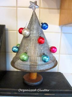 Berry Sieve Spool Christmas Tree www.organizedclutterqueen.blogspot.com