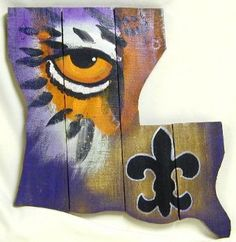 a board painting for Louisianians and fans of the LSU Tigers and New Orleans Saints