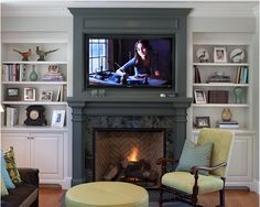 Sis, I think you need some contrast between your walls and fireplace on that big flat wall. It will break up the long wall and be more of a focal point. Dwellings By DeVore