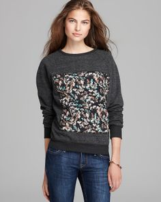 PJK Patterson J. Kincaid Pullover in Black Multi. I love how this baggy sweatshirt gets a dressy makeover with a printed floral silk panel.