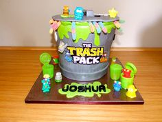 "A cake for a boy who loves ""Trash Pack"". A bit different but was fun to do.     Design A Cakes & Cupcakes"