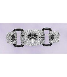 An Art Deco Diamond and Onyx Brooch