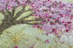 Blossoms on Yellow, detail Falling petals made of knots and beads. Fluffy yarn couched into place to add soft effect