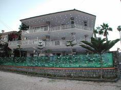 Aquarium fence surrounds the house