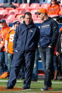 DENVER, CO - DECEMBER 13: Head coach Gary Kubiak of the Denver Broncos has a word with quarterback Peyton Manning, who was not suited up for the game, before a game between the Denver Broncos and the Oakland Raiders at Sports Authority Field at Mile High on December 13, 2015 in Denver, Colorado. (Photo by Doug Pensinger/Getty Images)