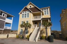 GRAND CAYMAN, #175 l Nags Head, NC Vacation Rental Home l Caribbean inspired oceanfront retreat with 8 bedrooms (4 masters), ocean views, elevator, recreation lounge with pool table and bar, home theater, loft with desk, heated pool, hot tub and private beach walkway with dune-top deck. Can be rented with adjacent home, Grand Tortola, #176.
