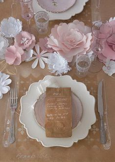 I'm loving those paper flowers in the center of the table, especially the big pale pink one!