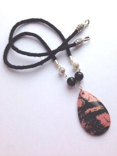 black braided necklace with a black and pink jasper teardrop pendant