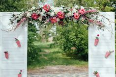 Shutters and flowers create a simple entrance archway.