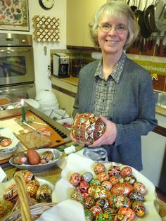 Pat Hall with her Ukrainian ostrich egg at the Orange Tree Imports egg art demonstration. We have all the supplies you need to decorate eggs (of any size) using this traditional technique.