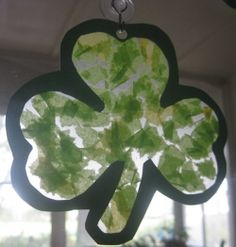 For this St. Patrick's Day, I decided to focus on green, shamrock-themed crafts with my toddler.  We made sun-catchers to hang on the glass doors...
