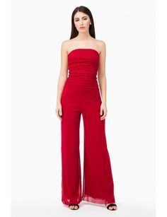 Jumpsuit with flare pants. Strapless. Lined. Model shown is 177 cm wearing a size Small. Made in Italy