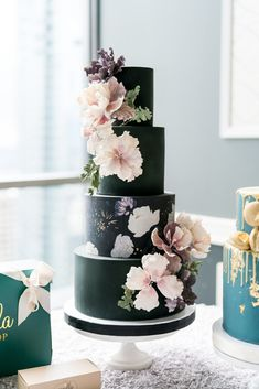Onyx four-tiered wedding cake featuring a floral pattern and handmade sugar flowers created by Vanilla Bake Shop. Onyx four-tiered wedding cake featuring a floral pattern and handmade sugar flowers created by Vanilla Bake Shop. Black Wedding Cakes, Floral Wedding Cakes, Elegant Wedding Cakes, Wedding Cakes With Flowers, Cool Wedding Cakes, Beautiful Wedding Cakes, Gorgeous Cakes, Wedding Cake Designs, Amazing Cakes