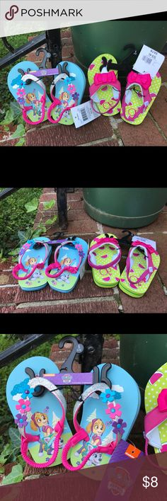 NWT 2 Pr Flip Flops Paw Patrol & OP Melon S 5-6 New with tags girls 2 pairs of flip flops size S 5-6. Flip Flops shoes are Nickelodeon Paw Patrols and OP Watermelon. Both are made in China of all man made materials. Paw Patrol are aqua color with 2 dogs & The straps are pink with silver glitter and 3 flowers. OP ones are lime with pink watermelon slices and pink straps with a pink bow. Both have Elastic straps Nickelodeon & OP Shoes Sandals & Flip Flops