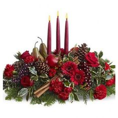 The bountiful joy of the season is brought home to your holiday table with this magnificent harvest-themed candle centerpiece, featuring an abundance of garden elements including grapes, pears, a pomegranate and cinnamon sticks