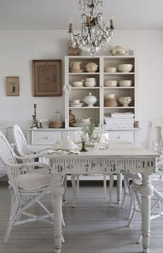 Simple white shabby chic dinning area with cabinets.