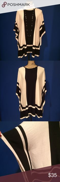 "August Silk Creme/Black sweater poncho NWT. 🚫No offers. Pit to pit approximately 38""laying flat. Sleeve width approximately 9"".  Could easily fit a large. Paired with a simple cream color turtle neck and the long black beads for sale in my closet. 💰I offer a 10% bundle discount on 3 or more items. august silk Sweaters Shrugs & Ponchos"