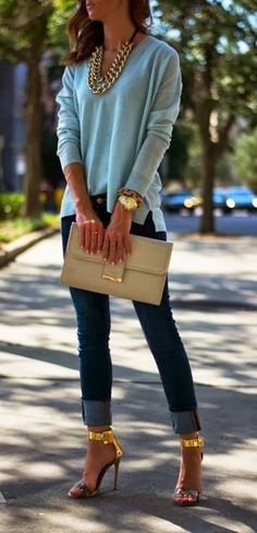 Adorable light blue blouse, golden necklace, jeans and high heels/