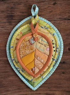Leaf Potholders by PatchworkPottery, via Flickr