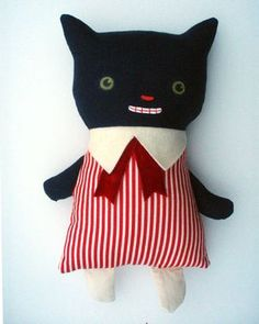 Black Apple totally feeds my compulsion to stay home and make odd little dolls out of my fabric stash.