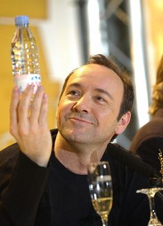 Chasing Spacey • Kevin Spacey bemused by his bottle of Evian. A...