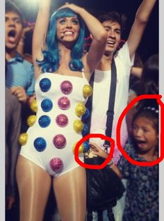 Little girl is so excited to be touching Katy Perry's outfit