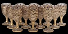 Set of 12 Bohemian glass richly gilt goblets by Moser, c. 1900