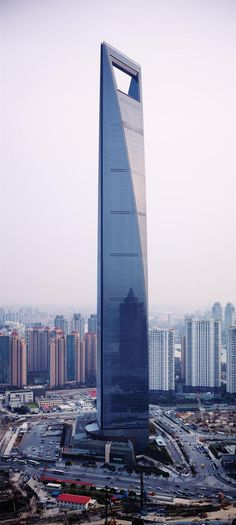The Shanghai World Financial Center is a skyscraper located in the Pudong district of Shanghai, China. It was designed by Kohn Pedersen Fox and developed by the Japanese Mori Building Company. It is a mixed-use skyscraper, consisting of offices, hotels, c Unusual Buildings, Interesting Buildings, Amazing Buildings, Modern Buildings, Modern Houses, Office Buildings, Futuristic Architecture, Beautiful Architecture, Architecture Design