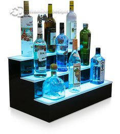 The most notable feature which makes this remote one of a kind is the ability to create your own custom color changing modes without the need for special software or hardware. Want to display ALL of your favorite sports teams colors? Glass Shelves Kitchen, Bar Shelves, Liquor Shelves, Shelf, Perfume Display, Bottle Display, Diy Home Bar, Bar Displays, Home Bar Designs