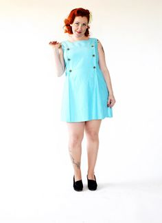 Gorgeous vintage 60s mini dress of great quality! The colour is a brigth turquoise. Slightly flared skirt. Pleaats two pleats down the front of the dress. Zipper in the back.   Square buttons with little golden beads as decorations. The material feels like it´s a great quality fabric, but I can´t say what it is. Fully lined.    Label. Gala of Sweden    Size: Medium/Large. The model is a size large, but use the measurements to be sure it fits you! Remember to leave some room for mevement…