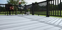 Deck new paint colors. Horizon decking in Castle Gray with black Mission railing Black Railing, Black Deck, Deck Railings, Black Pergola, Gray Deck, Deck Stain Colors, Deck Colors, Paint Colors, Colours