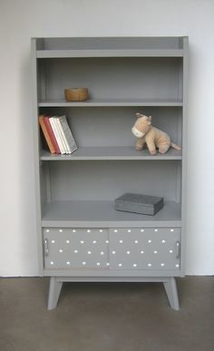 grey -- maybe paint those paired bookcases gray with white inside and redo the drawer pulls