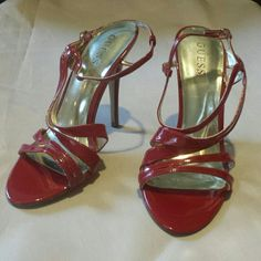 """Guess red strappy heels Sexy Guess 5"""" heels. Previously worn with love. No marks on heels...some scuffs on inside of right shoe strap shown in pic 4. Guess Shoes Heels"""