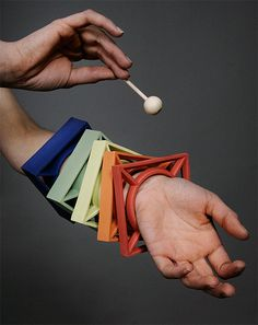 Xylophone Bangles... You would always be able to get the kids attention, no matter where or when.  Hang the mallet on your lanyard... COOL