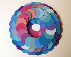 Paint Chip Wreath. Using paint chips in various shades of berry from your local paint store (be sure to ask first!).